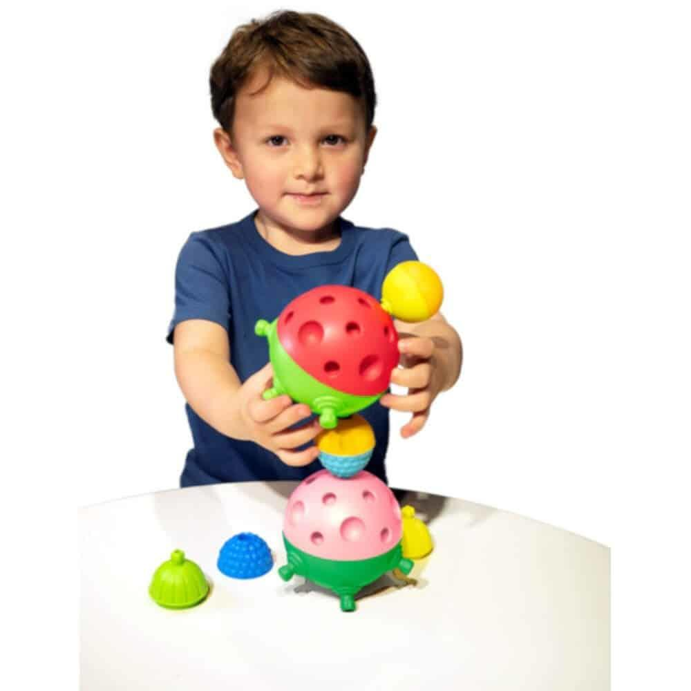 Young boy putting colourful sensory balls together.