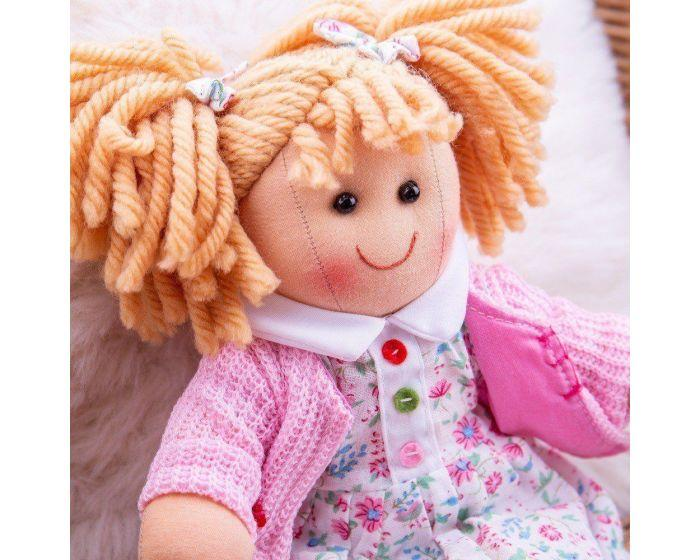 Image of Poppy ragdoll with her removable dress and cardigan beside her.