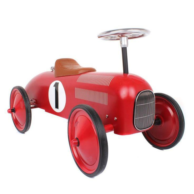 Red Vilac ride-on car front view.