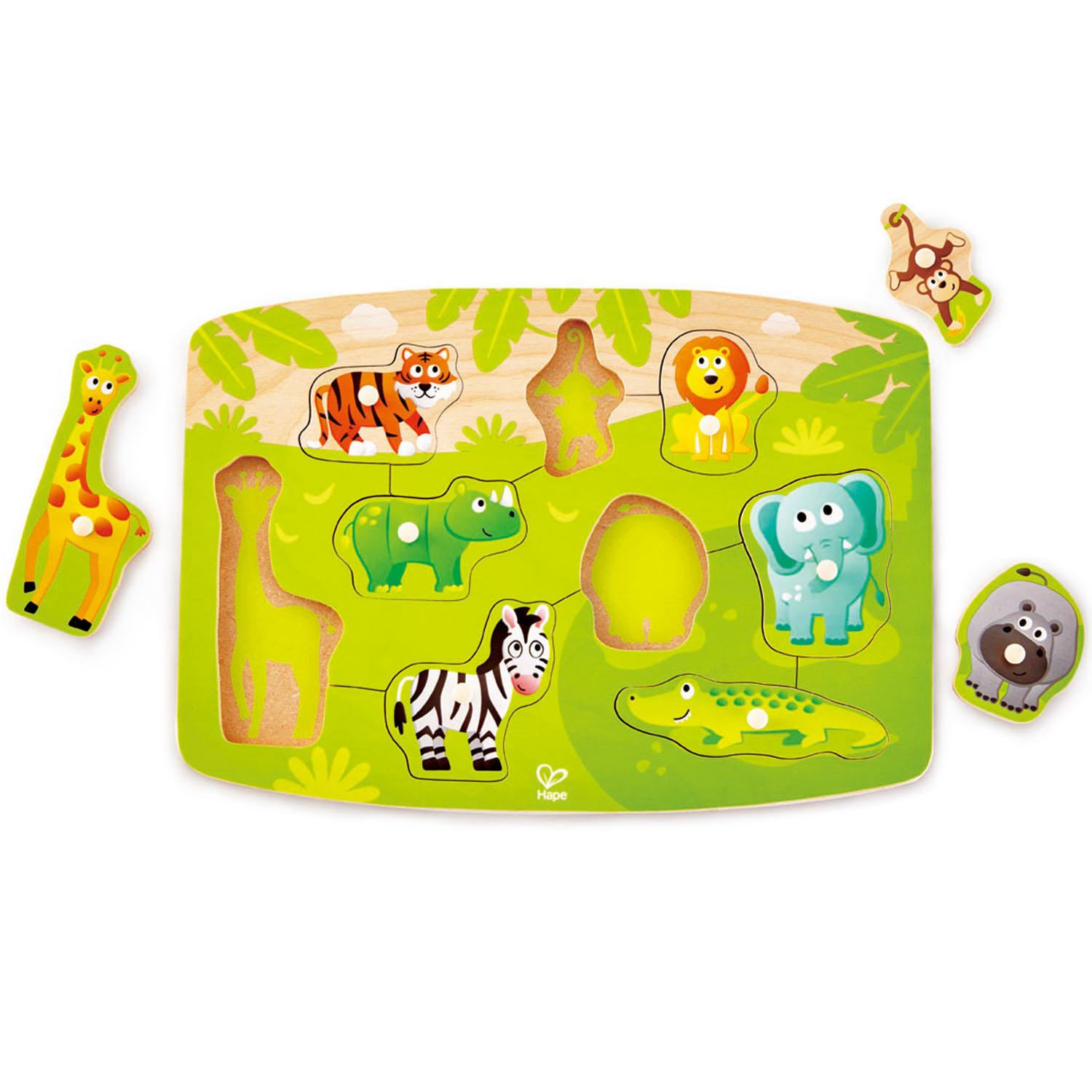 Green, jungle-themed puzzle with different animal pieces that have been lifted out.