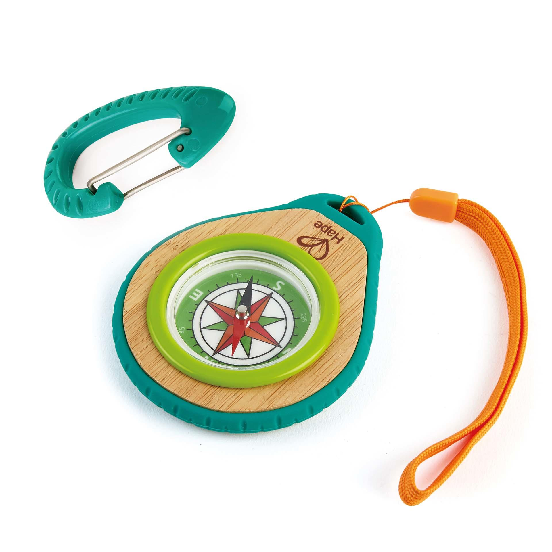 Compass with an orange handle plus a green carabiner on a white background.