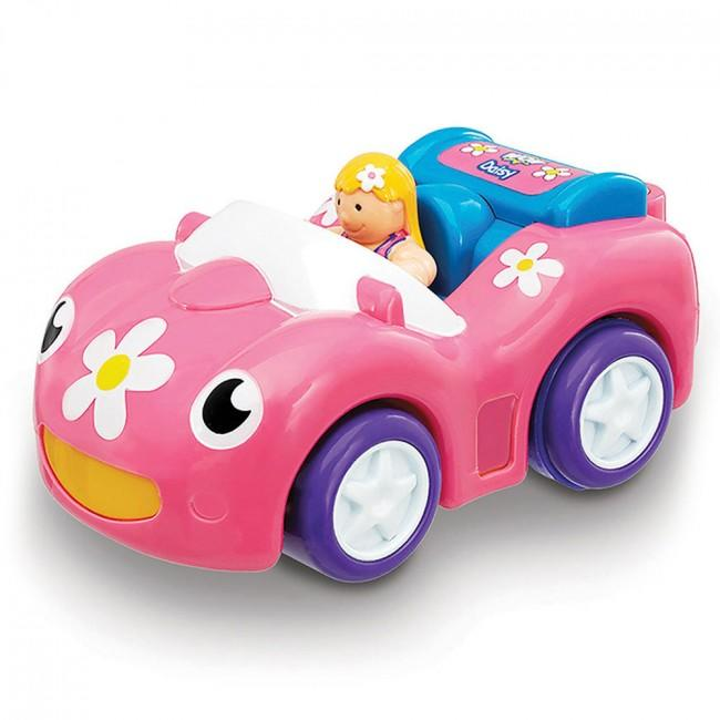 Toy car with daisy pattern and small doll.