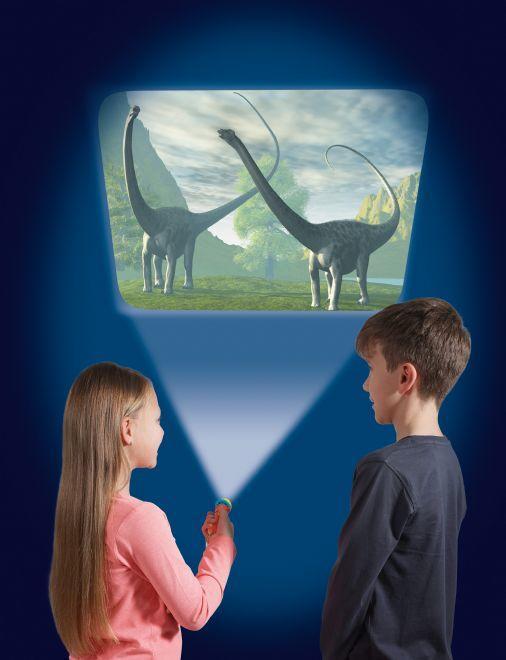 Boy and girl holding a projector torch and projecting an image of dinosaurs onto a wall.