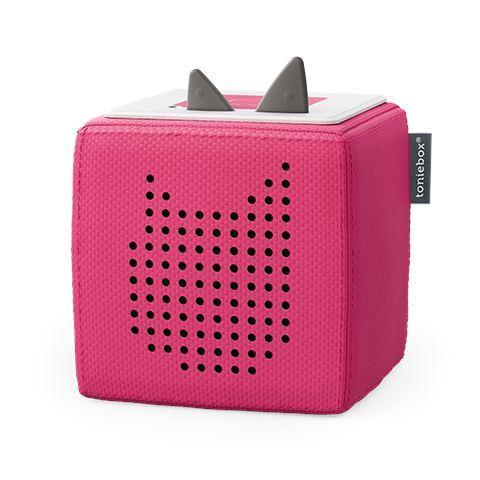 Pink Toniebox cube on white background.
