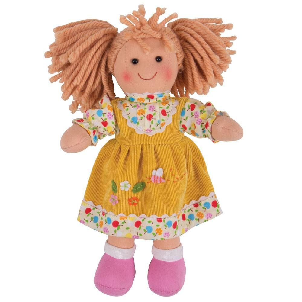 Rag doll with yellow cord pinafore dress.