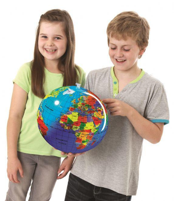 Girl and boy looking at an inflated globe.