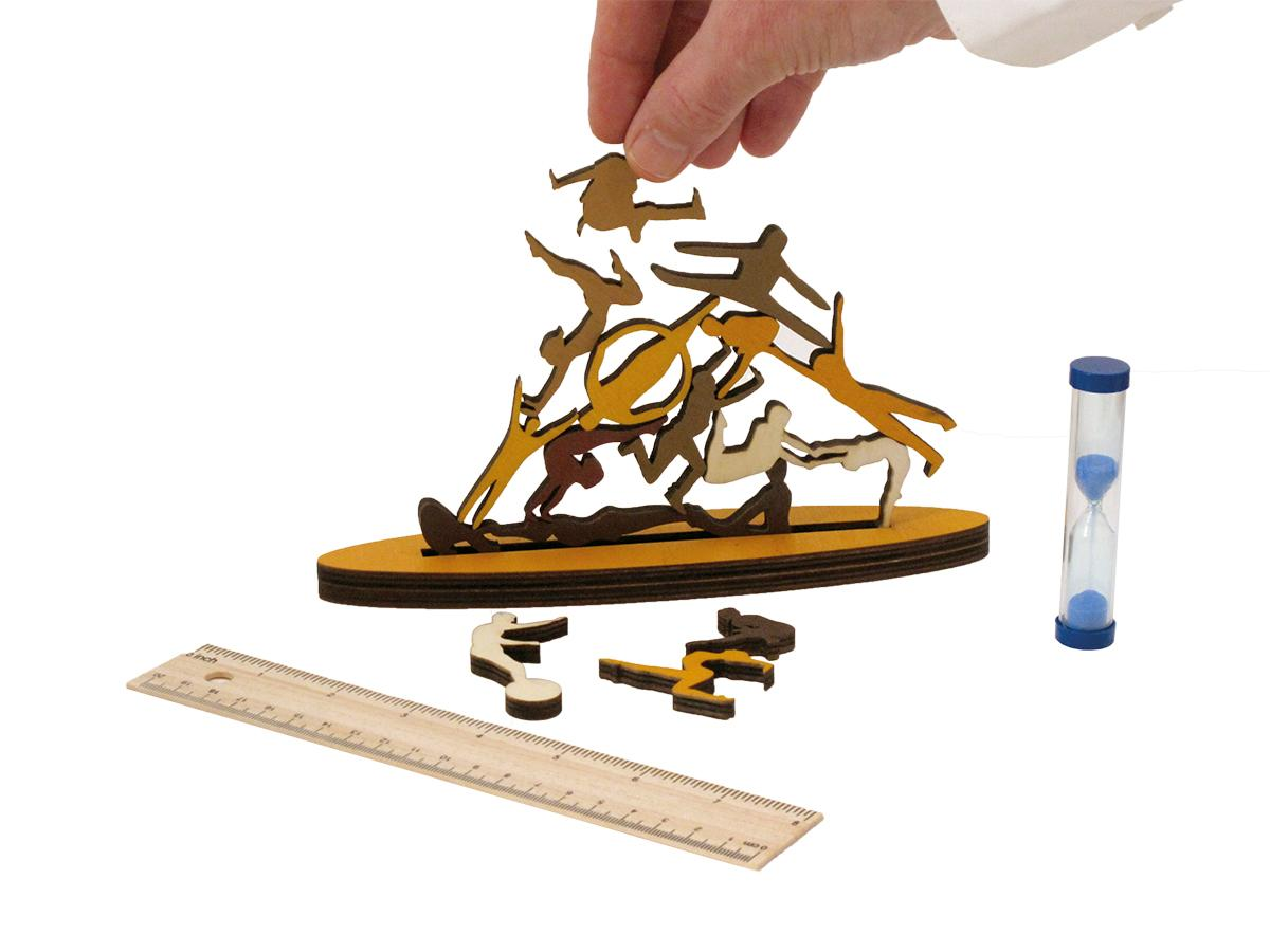 Wooden stacking game with pieces shaped like acrobats.