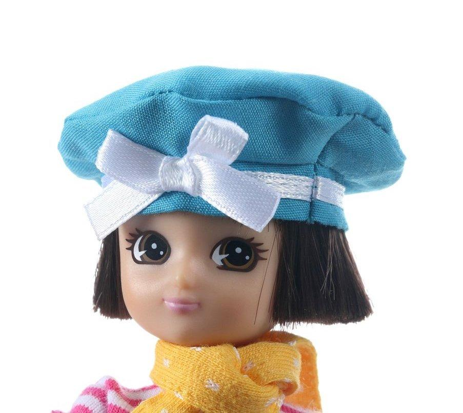 Close up of Lottie 'Always Artsy' doll's head wearing a blue beret with white bow.