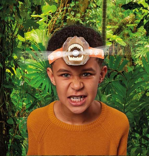 Boy wearing the T-rex-shaped head torch.