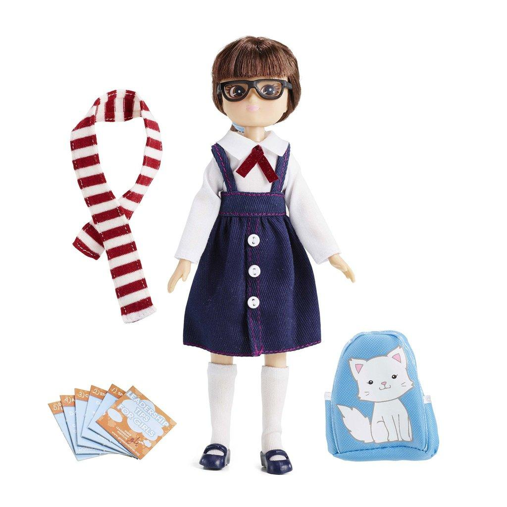 Lottie Doll School Girl Doll in pinafore with striped scarf and wearing glasses.