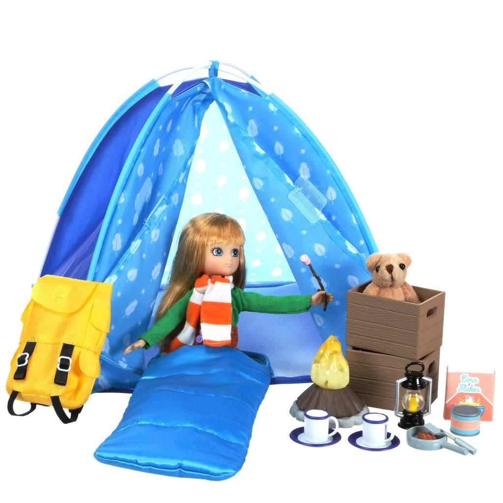 Lottie tent with teddy, sleeping bag, lantern and other camping accessories.