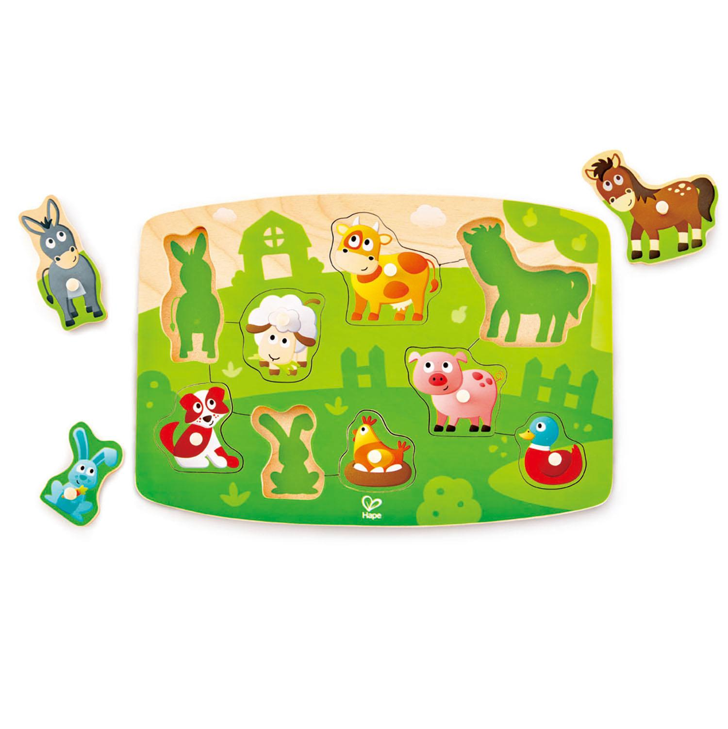 Farmyard-themed wooden puzzle with different animals that have been lifted out.