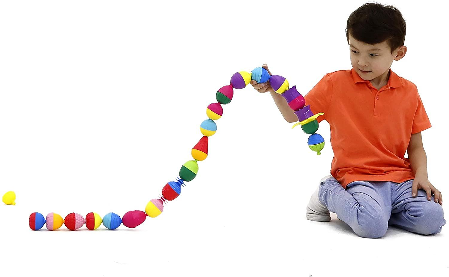 Boy playing with long string of Lalaboom brightly-coloured beads.