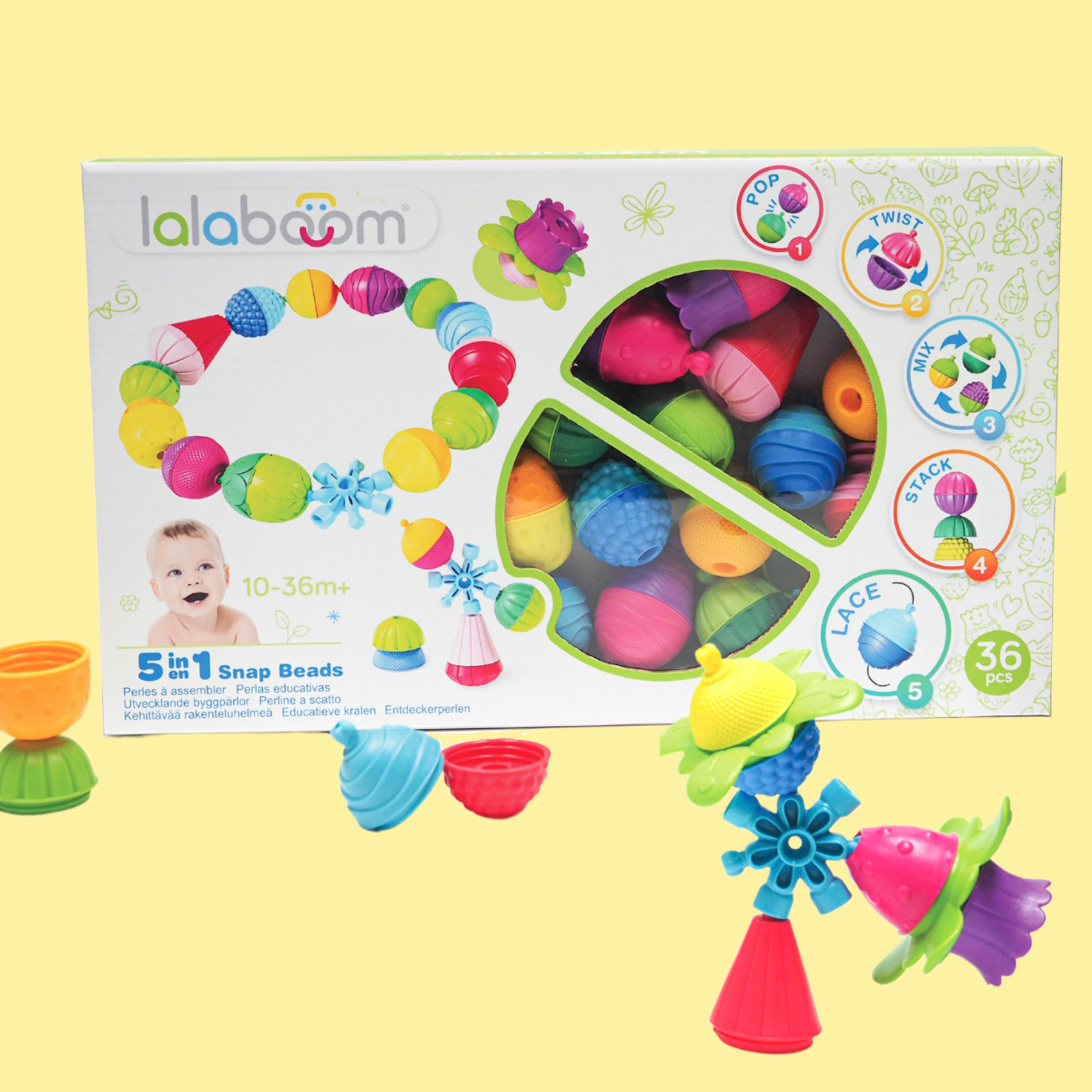 Lalaboom box of 36 pieces with yellow background with some brightly-coloured beads out of the box.