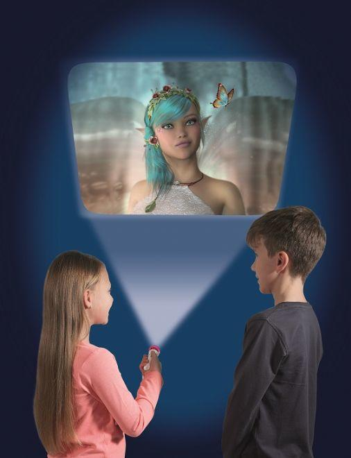Girl and boy projecting an images of a fairy onto a wall in a dark room.