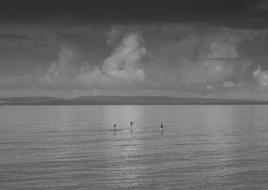 An image called Three Paddle Boarders - a future wall art print