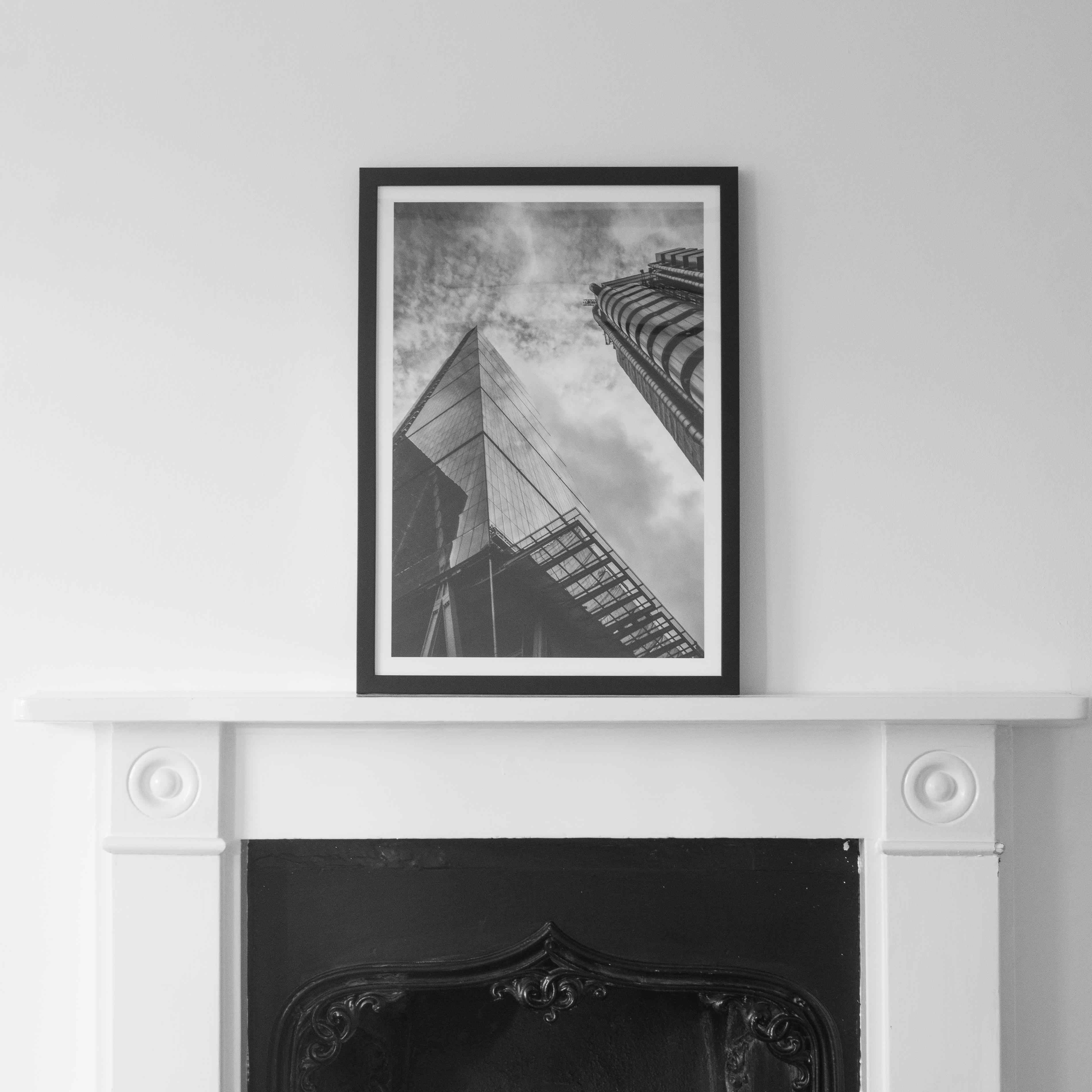 An image called Cheesegrater on a fireplace. A black and white image.