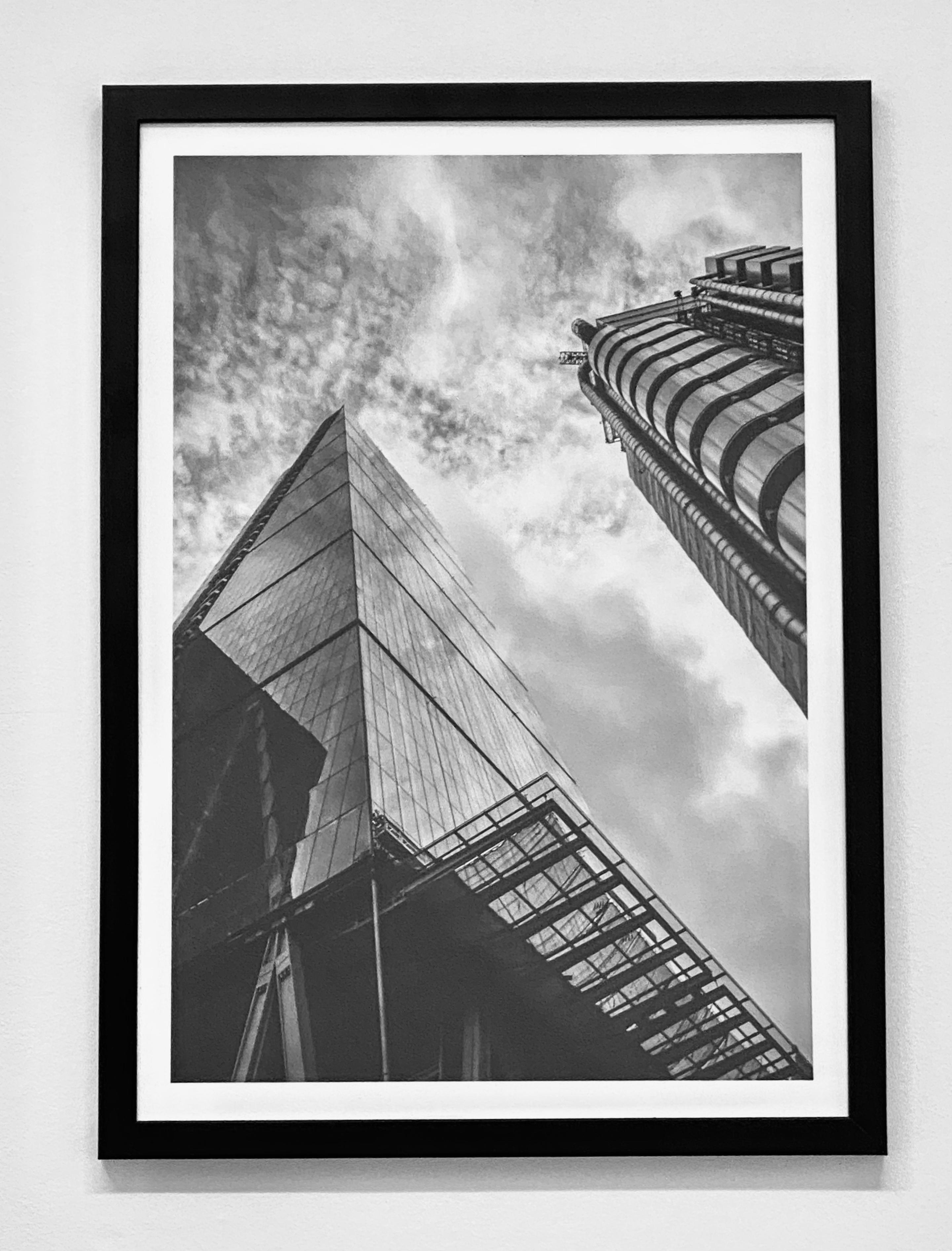 Our Cheesegrater wall art print from our London collection in a black frame, at A2 size.