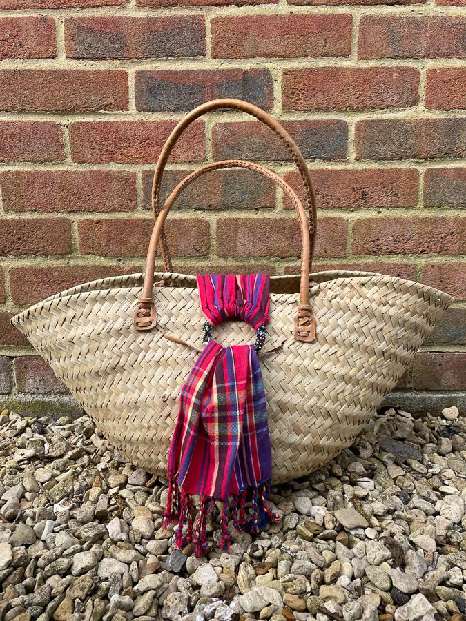 LARGE WOVEN BEACH BAG WITH LETHER HANDLES AND MULTI SCARF DETAIL CLOSURE29-03-2021 at 13.44.58 3.JPG