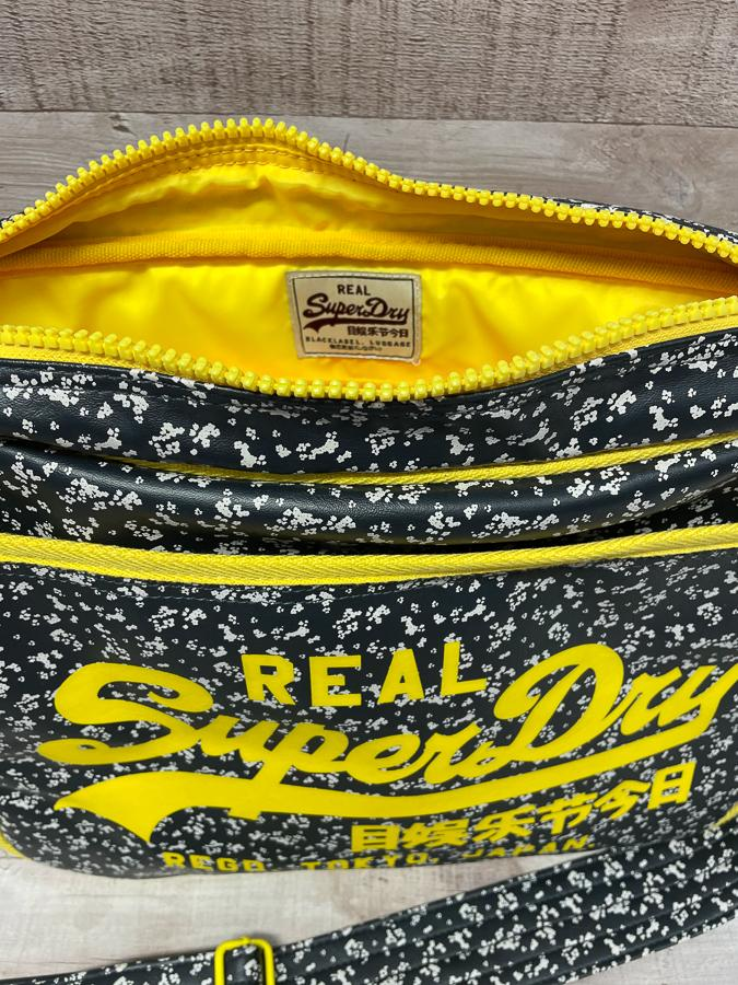SUPERDRY BLACK WHITE AND YELLOW RETRO STYLE SPORTS BAG09-04-2021 at 19.22.03 2.JPG