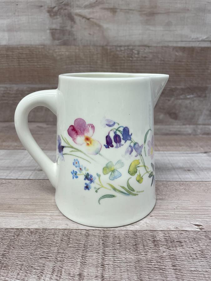 SMALL WHITE JUG WITH WATERCOLOUR FLOWER DESIGN.JPG