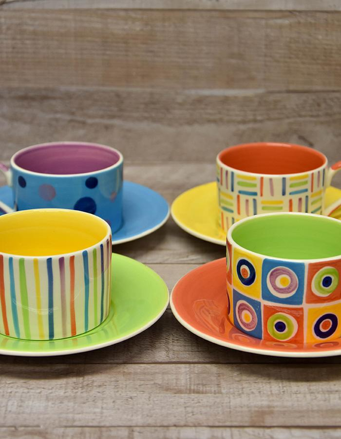 WHITTARD OF CHELSEA SET OF FOUR MULTI COLOURED CUPS AND SAUCERS