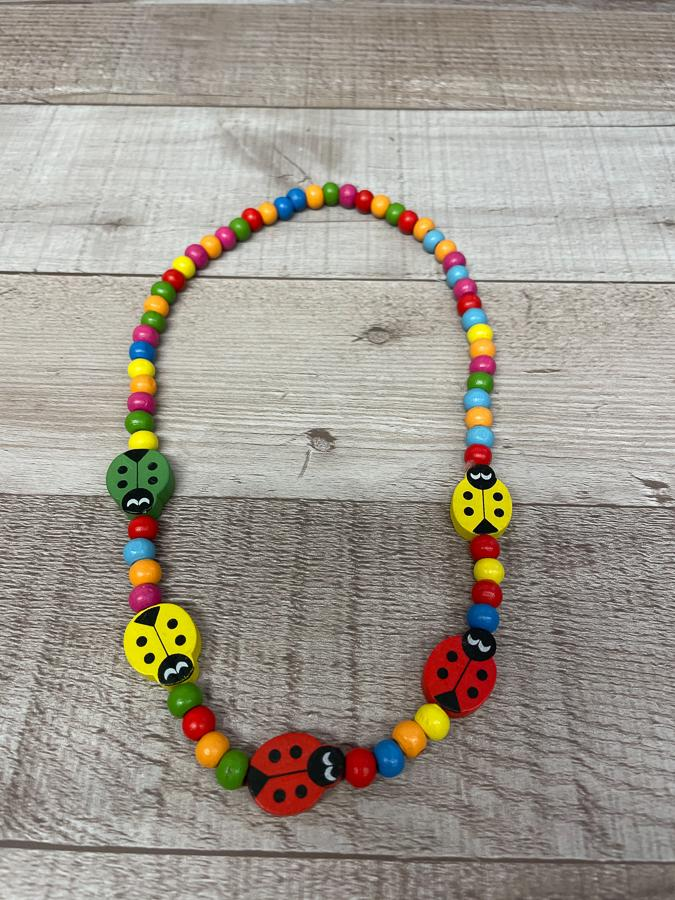 CHILDS MULTICOLOURED WOODEN LADYBIRD NECKLACE25-02-2021 at 20.41.59 2.JPG