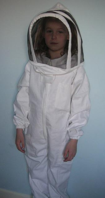 Child in White Fencing Beekeeping Suit