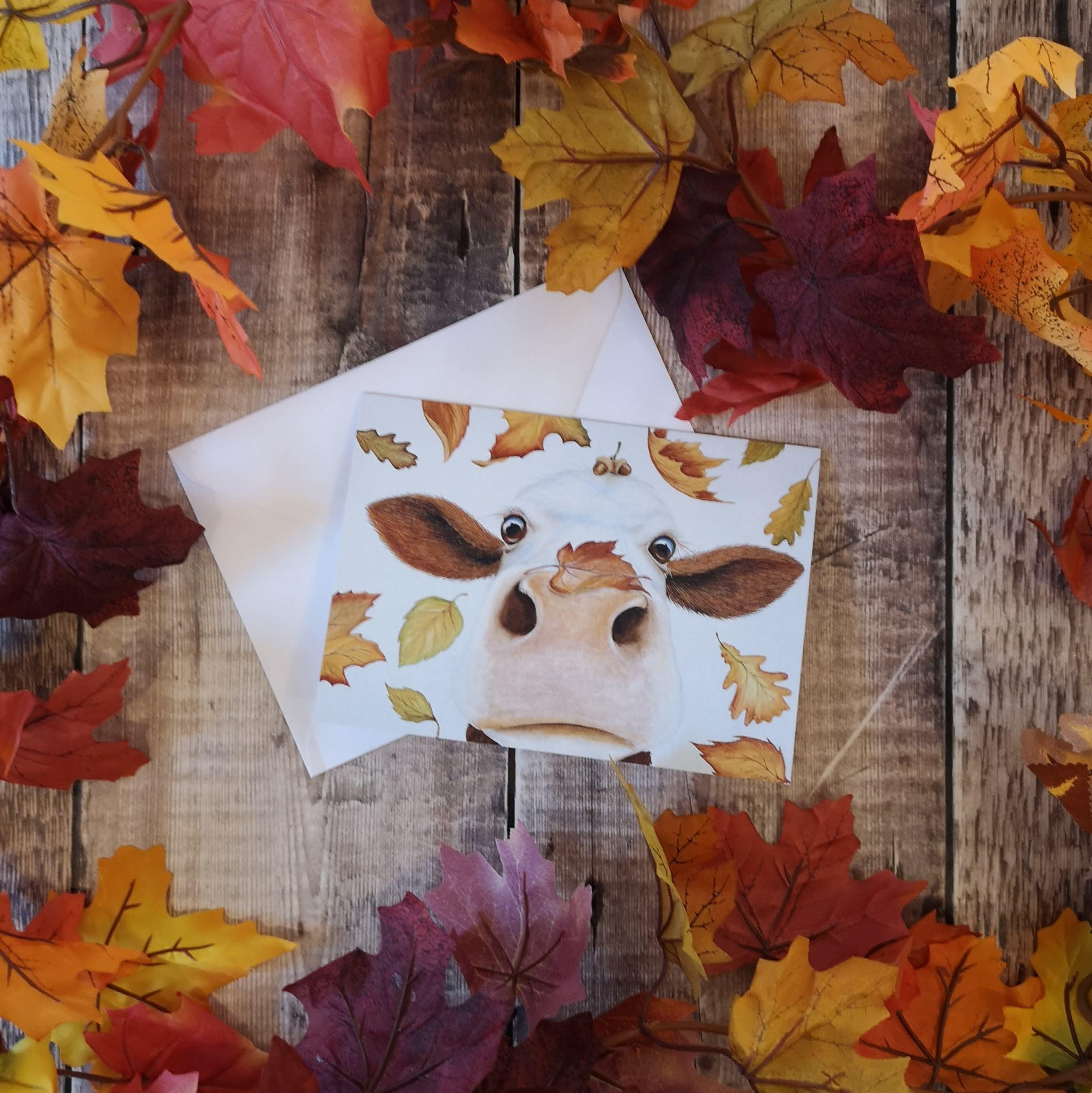 greetings card with an autumn inspired cow