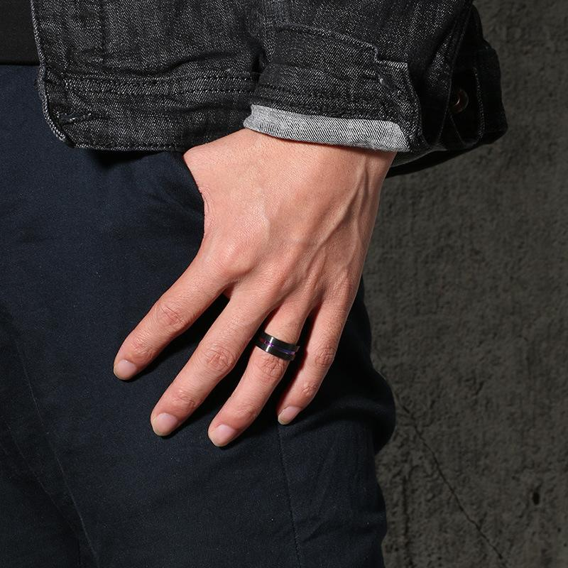 Black ring pictured on a hand