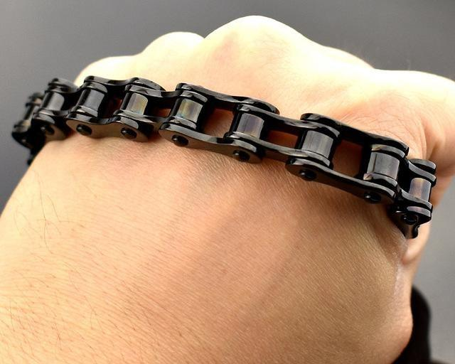 Black bike chain bracelet on hand