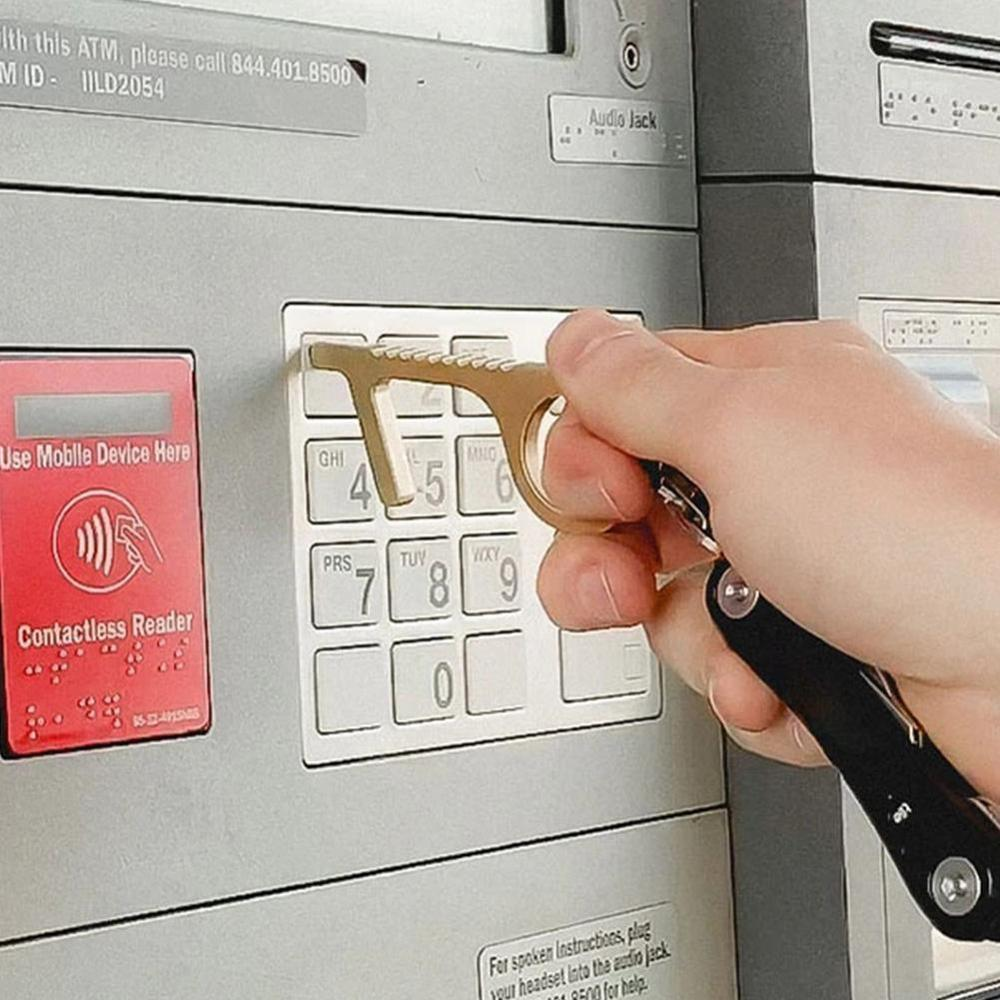 Tool being used on cash machine buttons