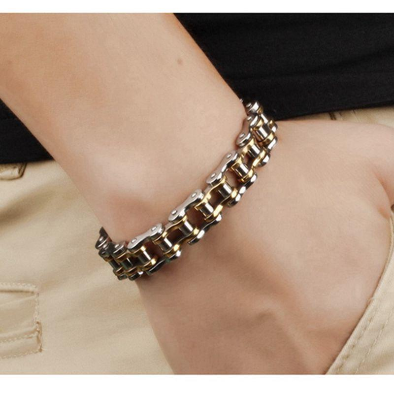 Silver and gold bracelet on a wrist