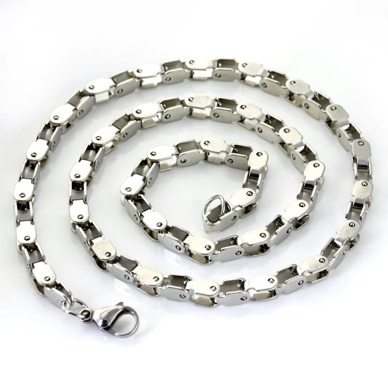 Bike chain necklace on white background