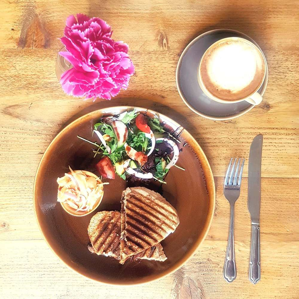 Delicious toastie coleslaw and salad with coffee at Lemana