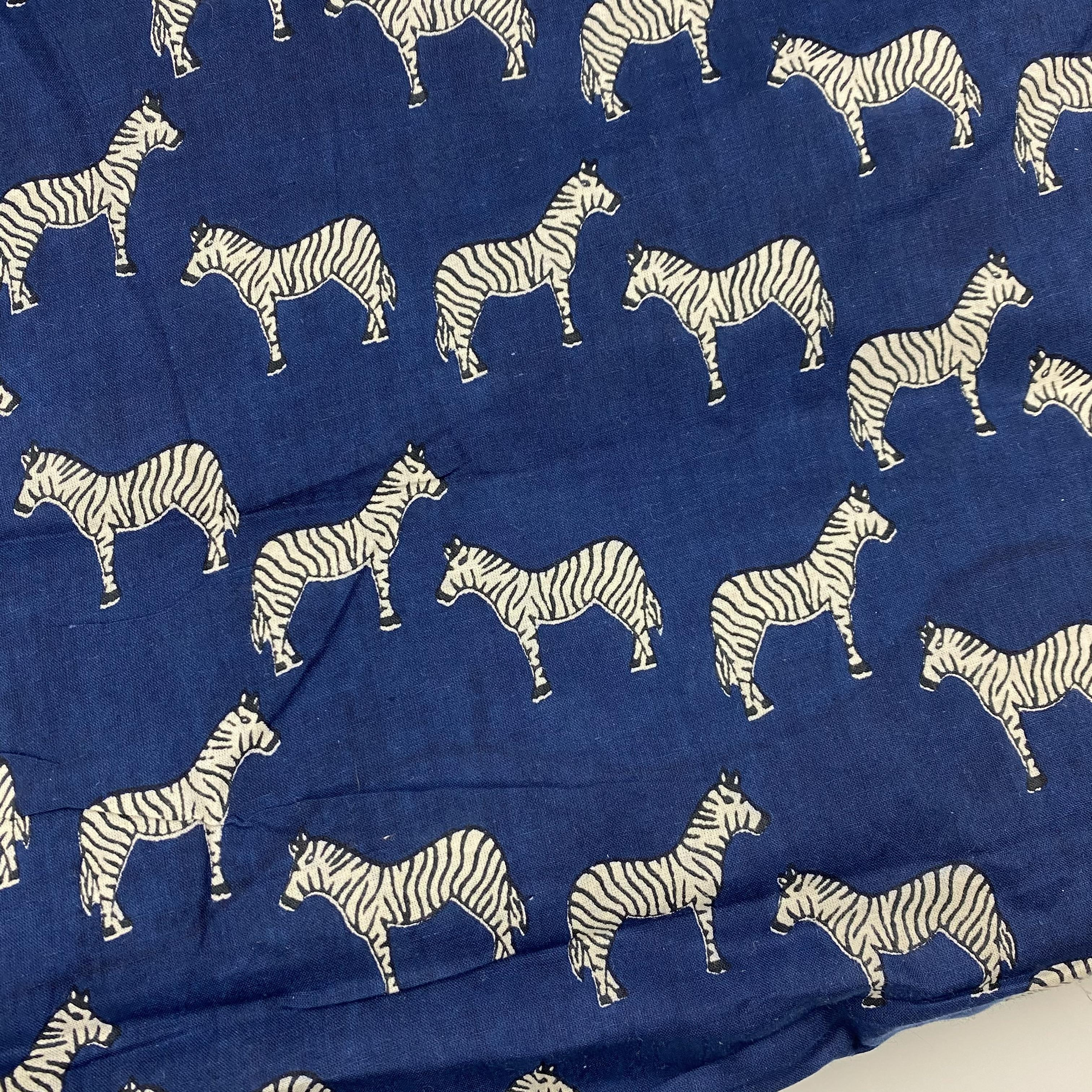 Navy cotton fabric with white zebra motif for pre order pajama shorts
