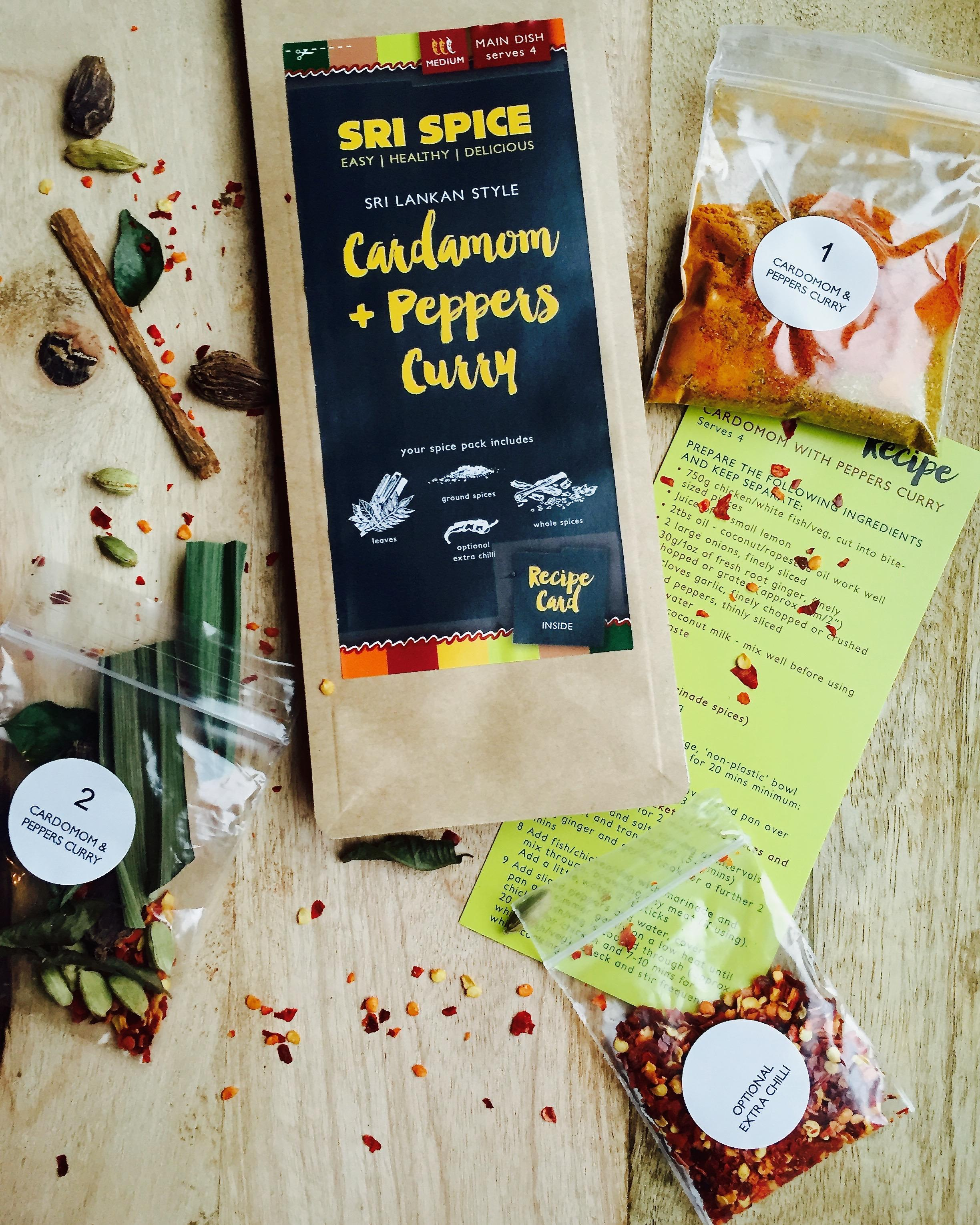 Cardamom and Peppers Curry kit with spices on a board