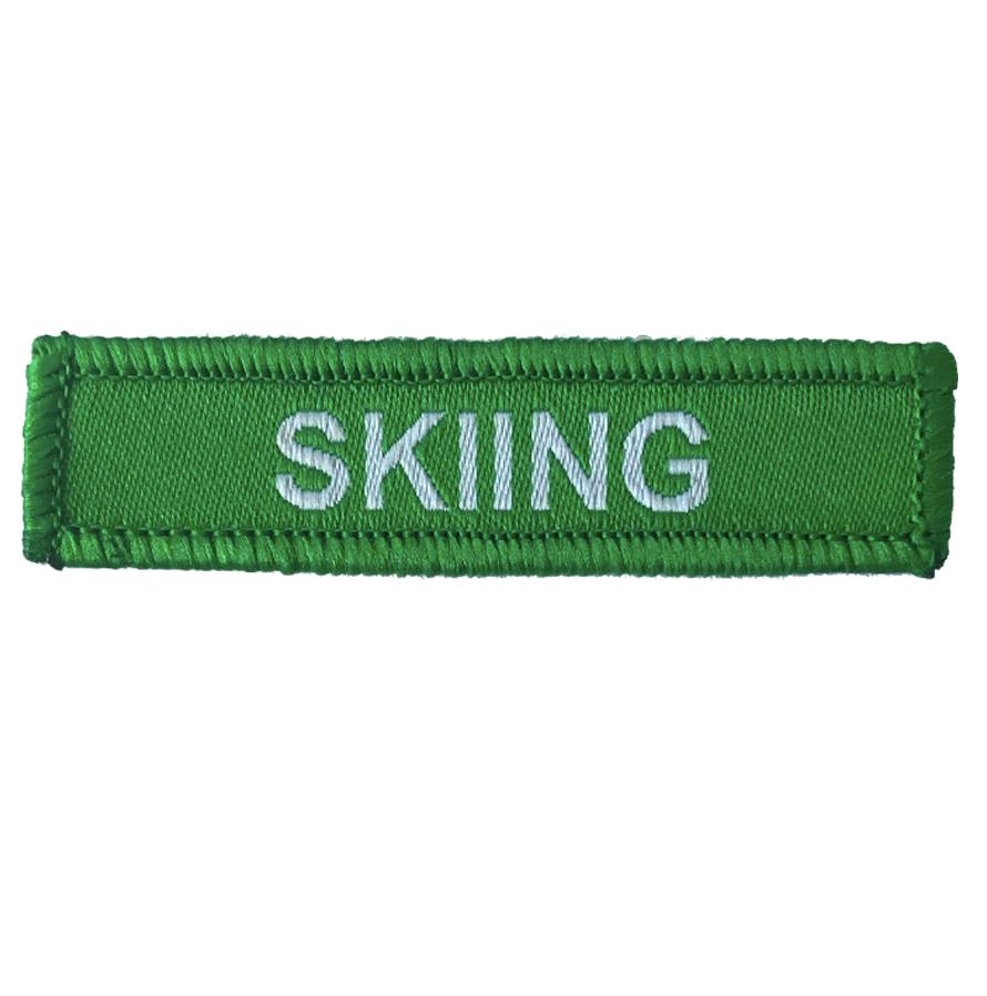 Skiing woven patches green