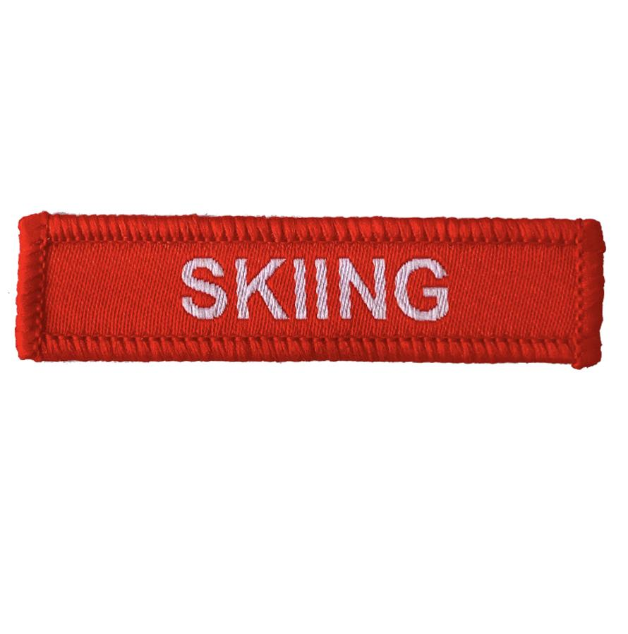 Skiing woven patches red