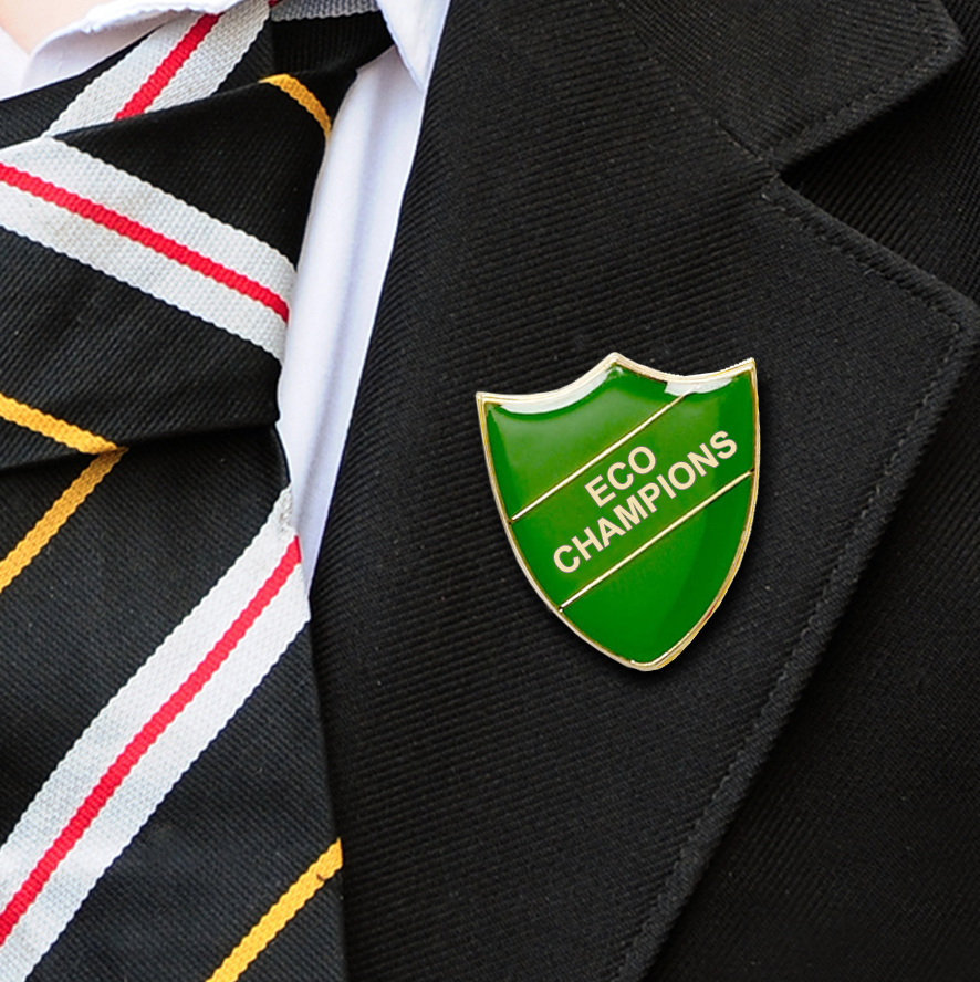 Green Shield Shaped Eco Champions Badge on Lapelle