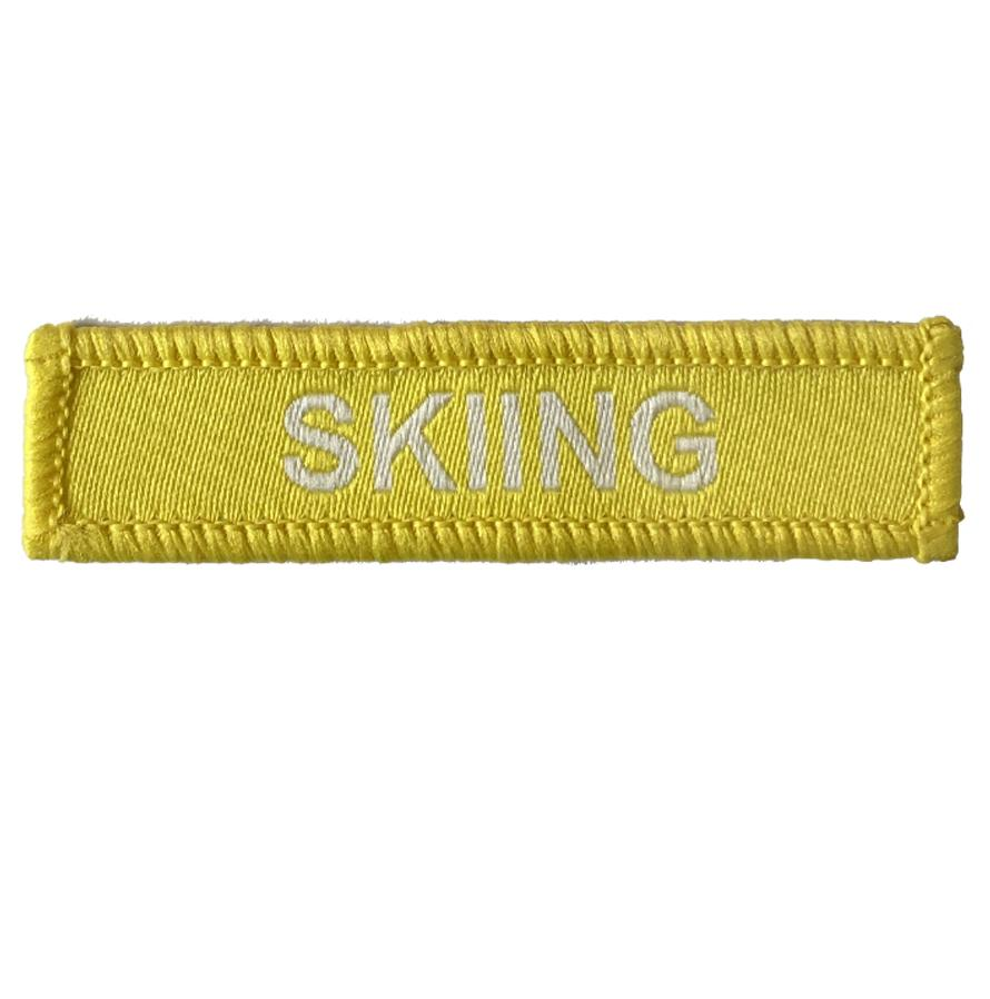Skiing woven patches yellow