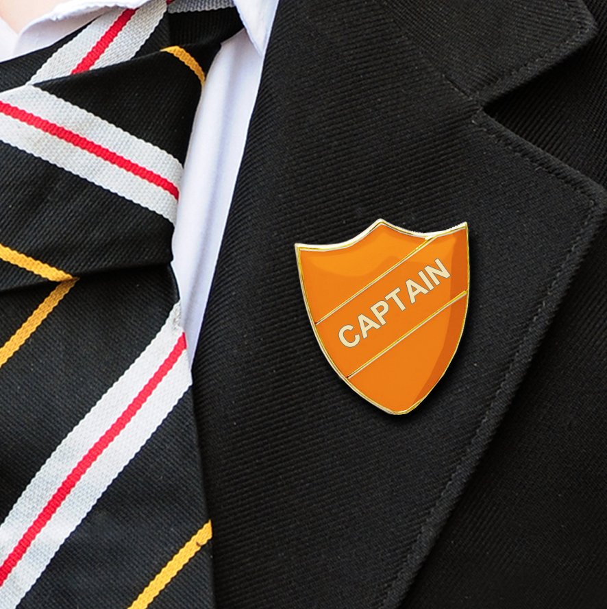 captain shield school badges orange