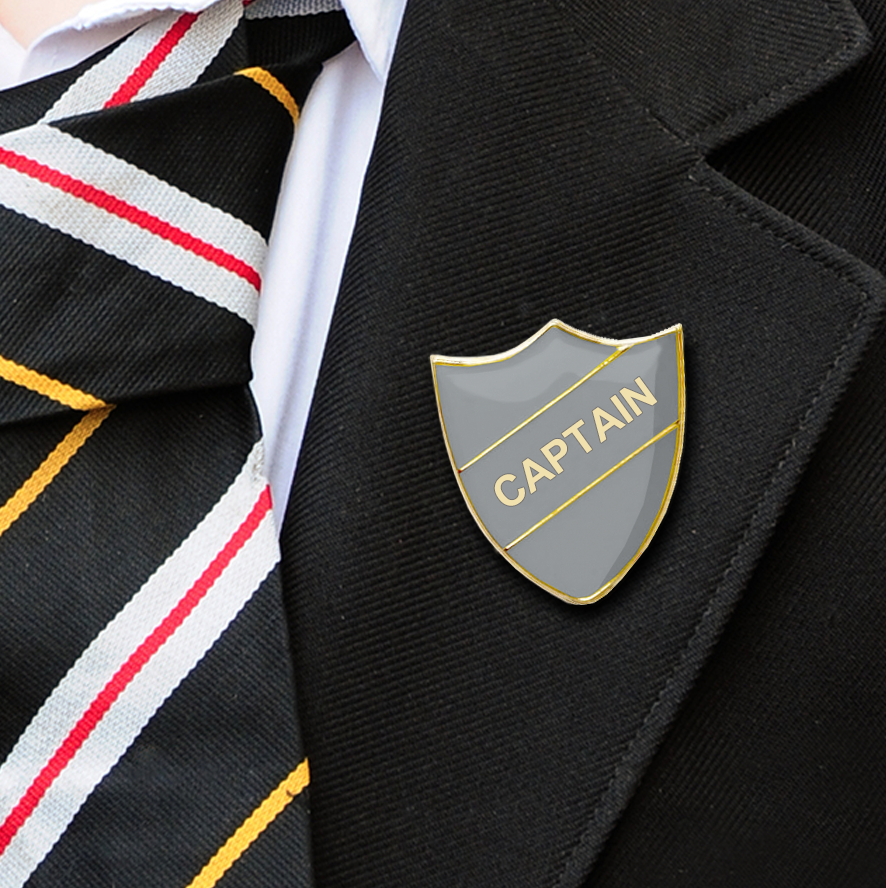 captain shield school badges grey