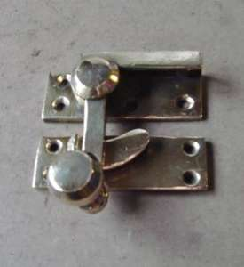 Victorian polished yellow brass sash window catch.