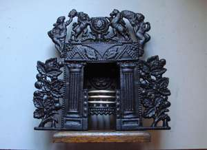19th Century Miniature Fireplace with Acorn decoration