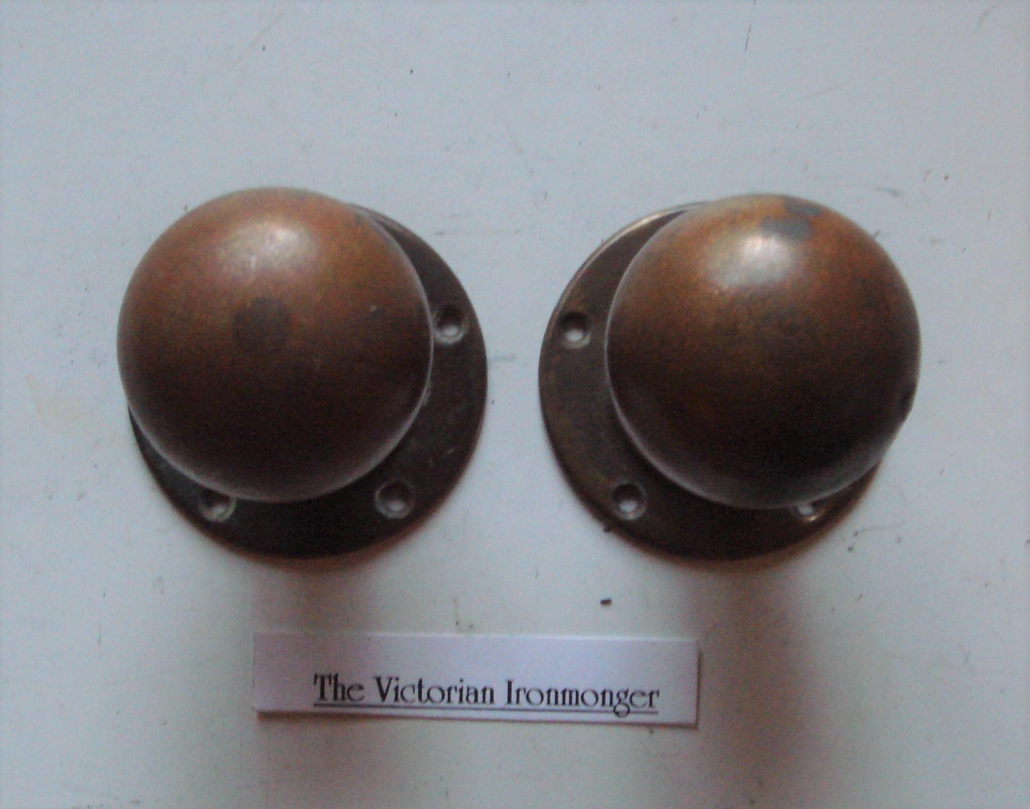 Large Pair of 1920's Ball Shaped Brass Door Knobs in Original Condition