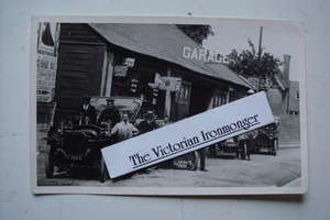 Old Black & White Postcard size Photograph of an Edwardian Garage, Cars & Enamel Signs