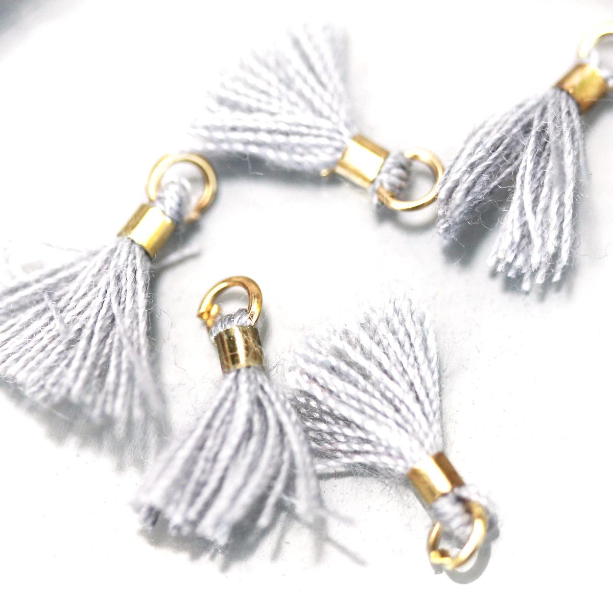 Grey Tiny Tassel with gold ring