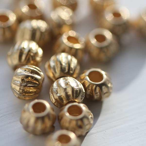 Small Melon gold metal bead