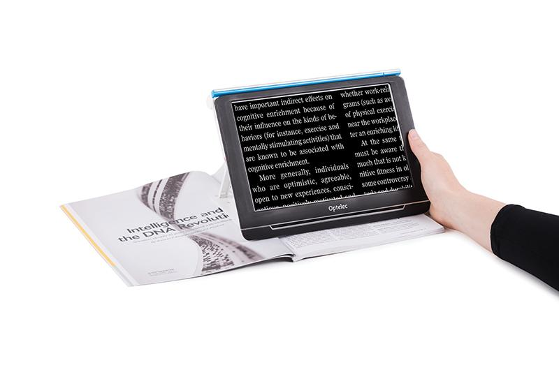 the Compact 10 HD sat over a magazine magnifing the text on the page